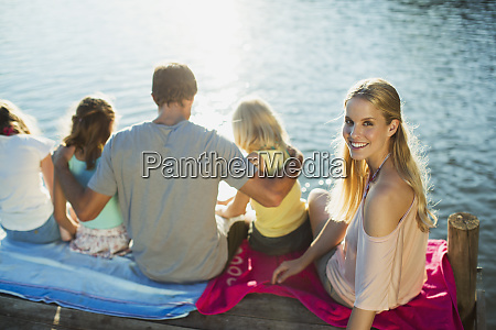 smiling woman with family on dock