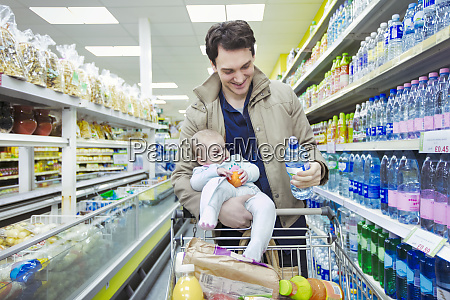 father with baby daughter shopping in