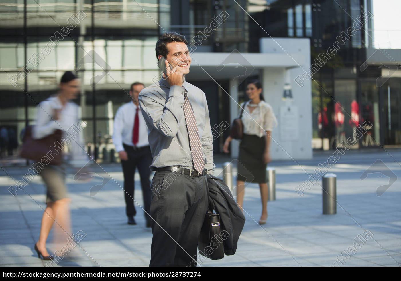 smiling, businessman, talking, on, cell, phone - 28737274