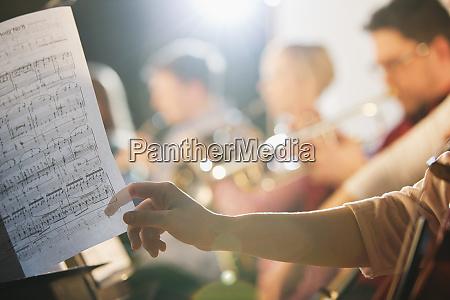 musician turning sheet music