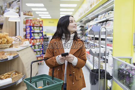 woman with smart phone shopping in