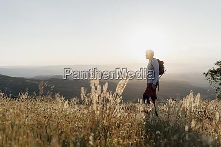 senior man standing on mountain while