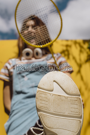 young woman holding badminton racket with