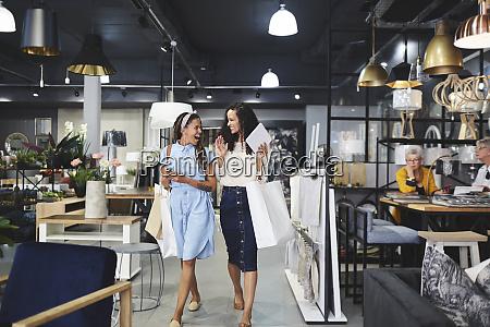 women shopping leaving home decor shop
