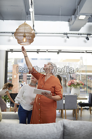 women with digital tablet shopping in