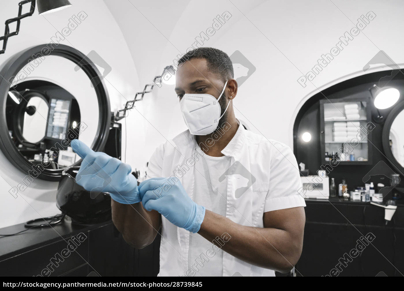 barber, wearing, surgical, mask, putting, on - 28739845