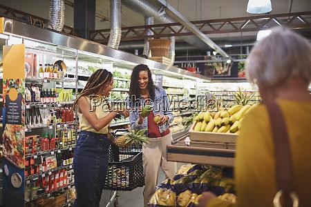 women shopping for fruit in supermarket
