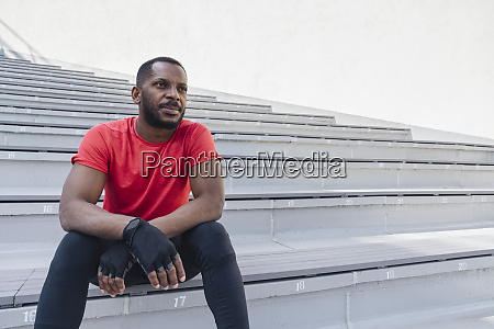 sportsman sitting on stairs having a
