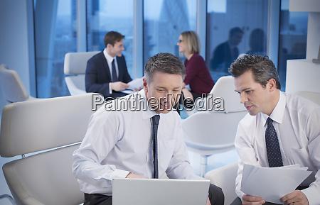 businessmen meeting in office