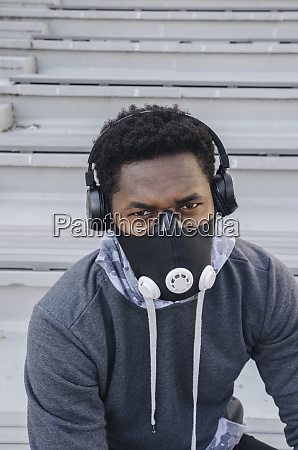 portrait of sportsman with headphones wearing