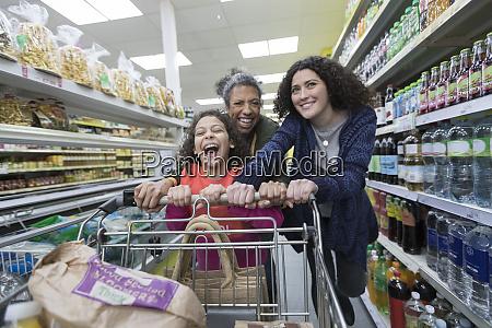 happy multi generation women grocery shopping