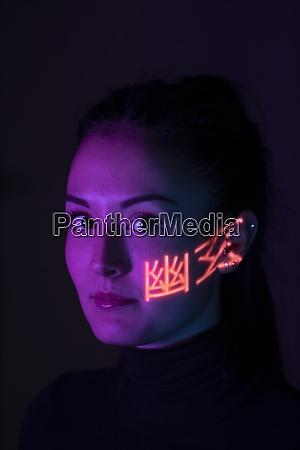 headshot of woman with light pattern