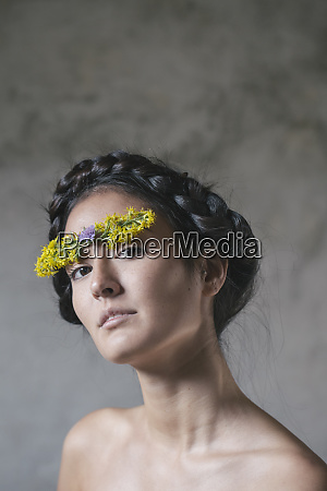 beautiful young woman with flower stuck