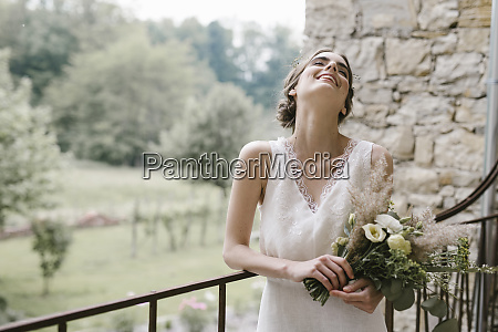 young smiling woman in elegant wedding
