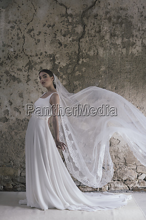 young posing woman wearing wedding dress