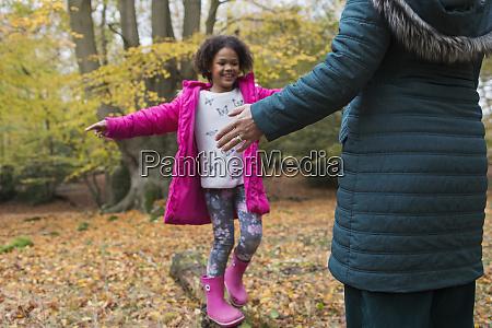 happy girl balance on fallen log