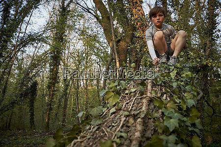 low angle view of boy climbing