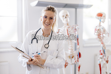 portrait of smiling female doctor with