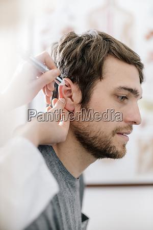 female alternative practitioner giving man acupuncture