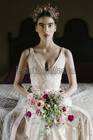 young, woman, wearing, wedding, dress, holding - 28741045