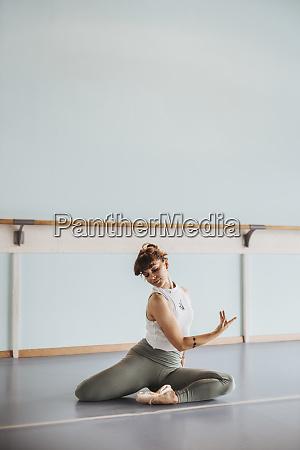 ballerina doing stretching exercises on floor