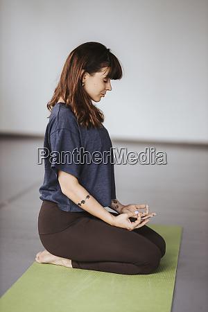 ballerina meditating on exercise mat in