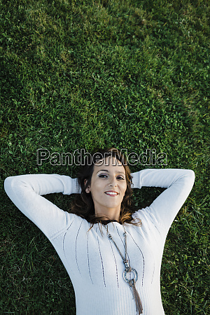 happy mid adult woman lying on