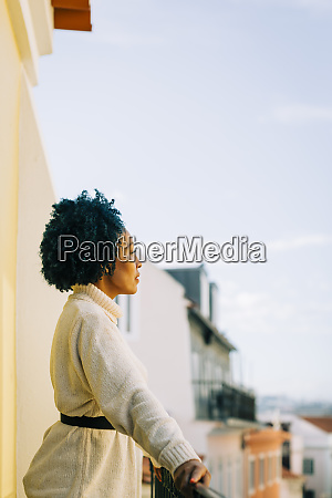 thoughtful woman with curly hair looking