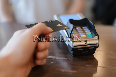 man paying with credit card in