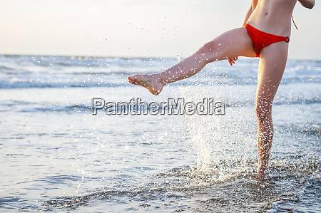 legs of a woman splashing with