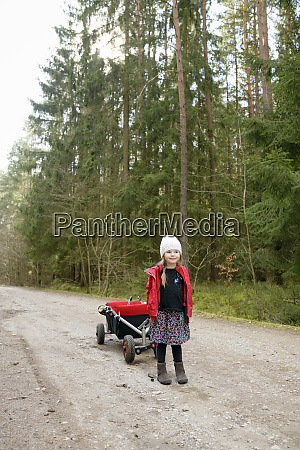 little girl with trolley standing on