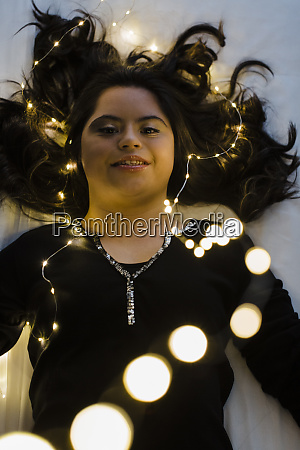 confident young woman with down syndrome