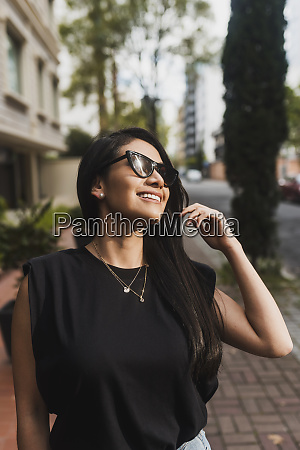 woman with sunglasses in city
