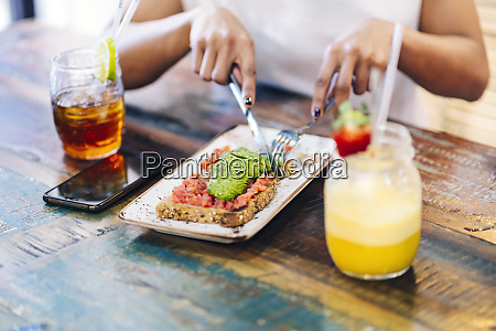 midsection of woman eating meal while