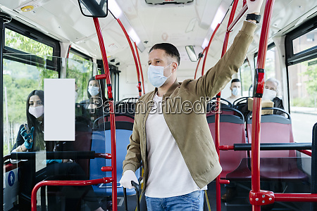 passengers wearing protective masks in public