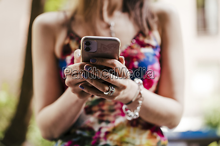 close up of woman holding mobile