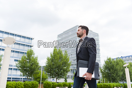 side view of confident professional walking