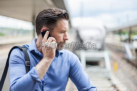 handsome businessman talking on smart phone
