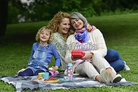 happy three generation females enjoying picnic