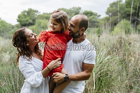 happy family enjoying at countryside
