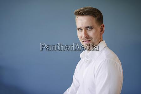 confident businessman looking at camera