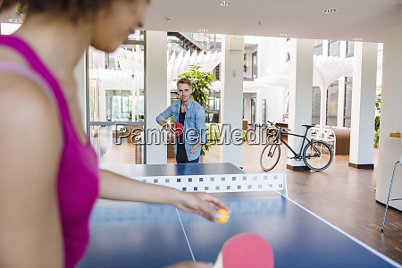 young business people plaing table tennis