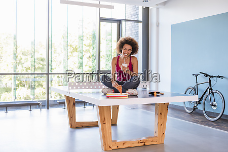 young woman sitting on ping pong
