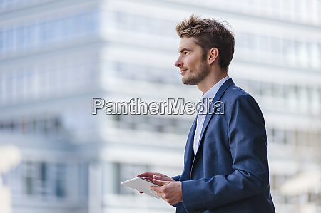 young businessman using tablet in the