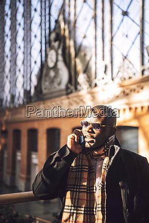 stylish businessman talking over smart phone