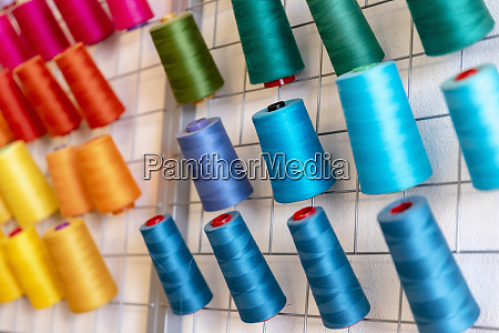 close up of colorful thread spools