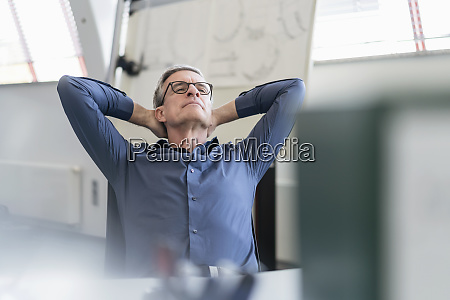 tired mature male professional relaxing while