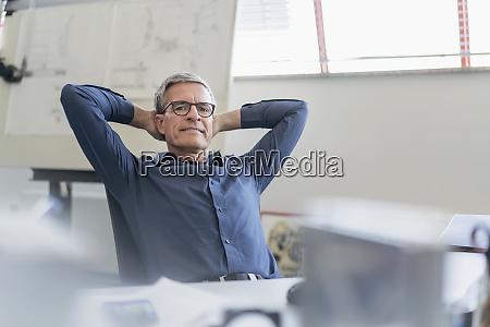 portrait of confident male entrepreneur relaxing