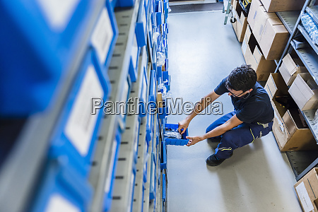 man in storage room of a