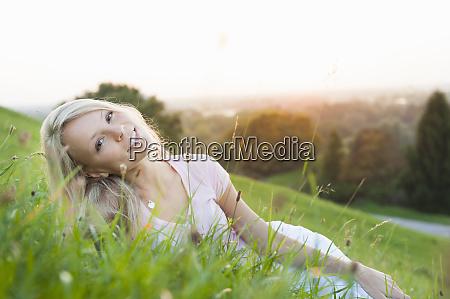 smiling young beautiful woman lying on